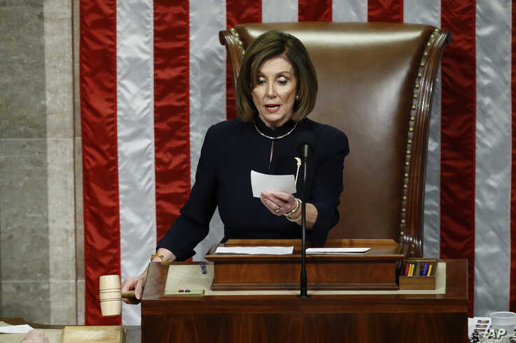 House Speaker Nancy Pelosi of Calif., readies to strike the gavel as she announces the passage of article II of impeachment against President Donald Trump, Dec. 18, 2019, on Capitol Hill in Washington.