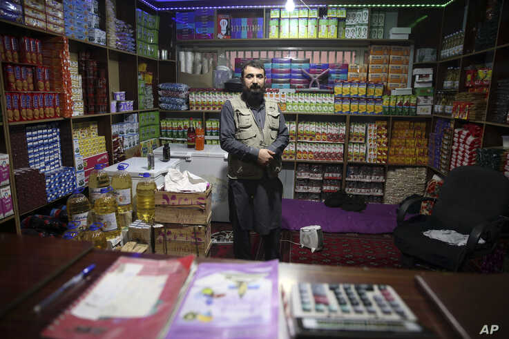 In this Dec. 14, 2019, photo, jailed Taliban shopkeeper poses for photograph inside the Pul-e-Charkhi jail in Kabul,…