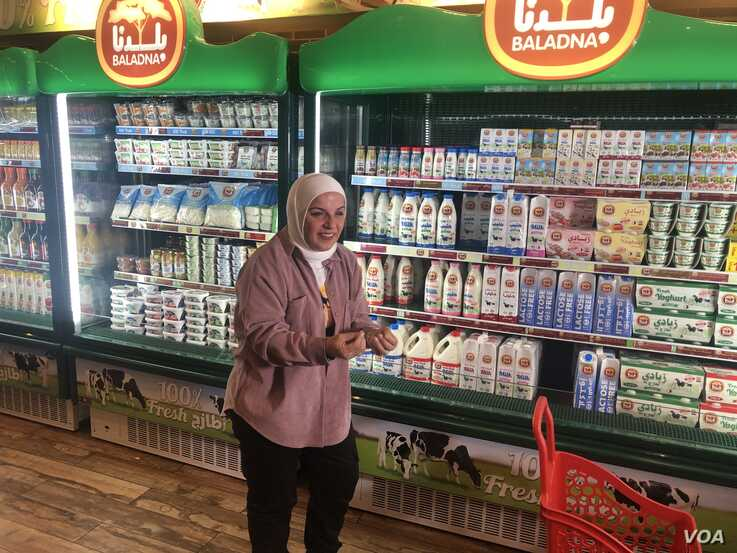 41-year-old homemaker Aman Qadodora says that after the insecurity caused by a blockade of neighboring states she's relieved to find local products at her neighborhood grocery store. (J.Wirtschafter/VOA)