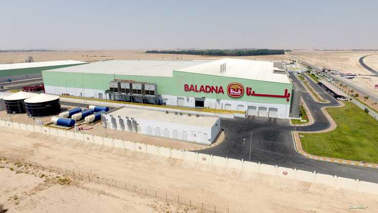 Baladna Dairy began operations within a month after Qatar's neighbors cut off  ties and imposed a trade blockade. More than 18,000 cows were transported from the U.S. to the small, landlocked gulf state by airplane and ship. (Courtesy Aladdin Idilbi)