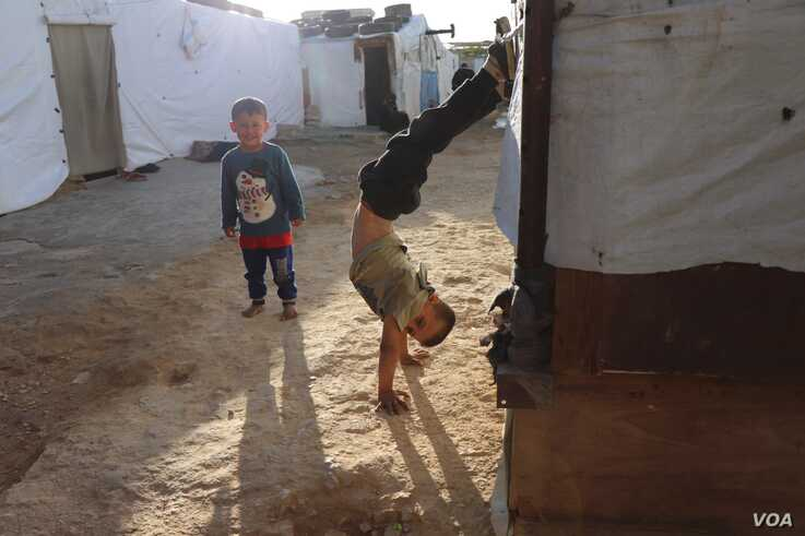 Syrian children play in Bekkaa Valley, Lebanon, Nov. 30, 2019. Right groups say the children are often not in school and are increasingly in danger of long-term statelessness. (Heather Murdock/VOA)