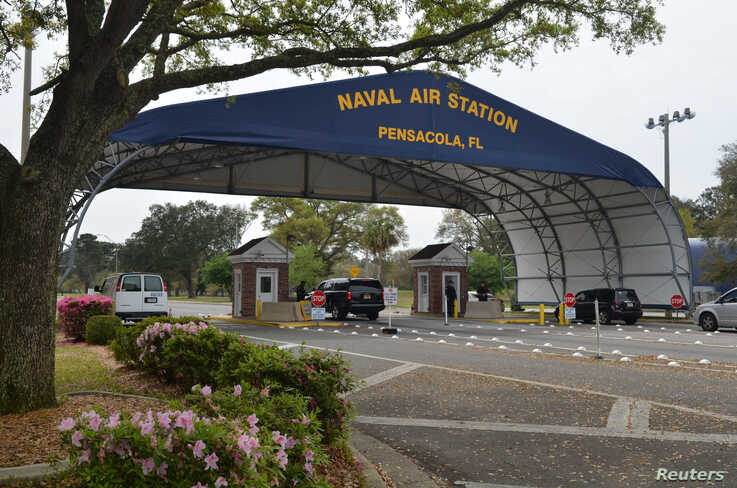 The main gate at Naval Air Station Pensacola is seen on Navy Boulevard in Pensacola, Florida, U.S. March 16, 2016. Picture…