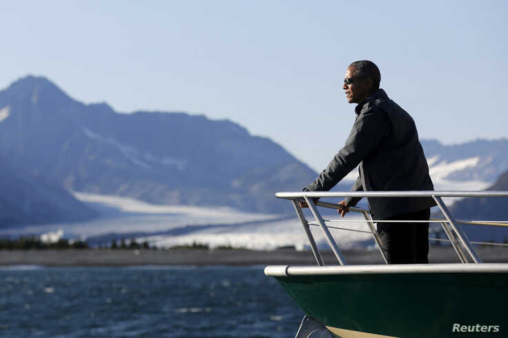 FILE PHOTO: U.S. President Barack Obama views Bear Glacier on a boat tour of Kenai Fjords National Park in Seward, Alaska…