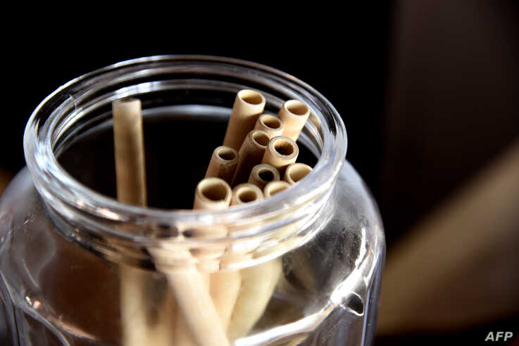 Bamboo straws are stored in a jar on a table at the Copacabana restaurant on Yoff Virage beach in Dakar, Senegal, Sept. 3, 2019.