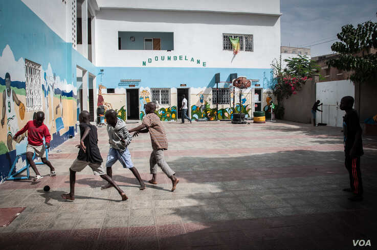 Talibés who were abused by their teachers play soccer at their shelter, Dec. 12, 2019, in Dakar, Senegal. (Annika Hammerschlag/VOA)