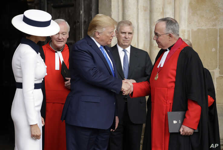 President Donald Trump and first lady Melania Trump accompanied by John Hall, the Dean of Westminster, right, and Britain's Prince Andrew leave after a tour of Westminster Abbey in London, June 3, 2019.