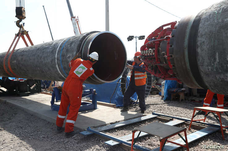 FILE - Workers are seen at a construction site of the Nord Stream 2 gas pipeline, near the town of Kingisepp, Leningrad region, Russia, June 5, 2019.