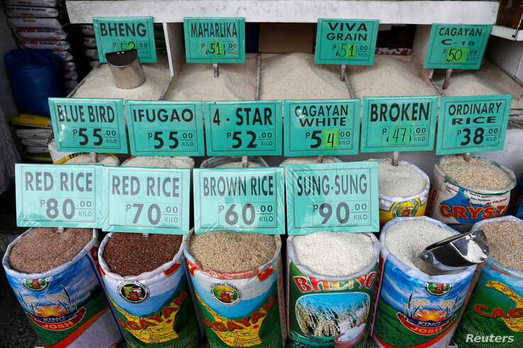 FILE - Different varieties of rice are seen for sale at a food market in Paranaque, Metro Manila, Philippines, Aug. 31, 2018.