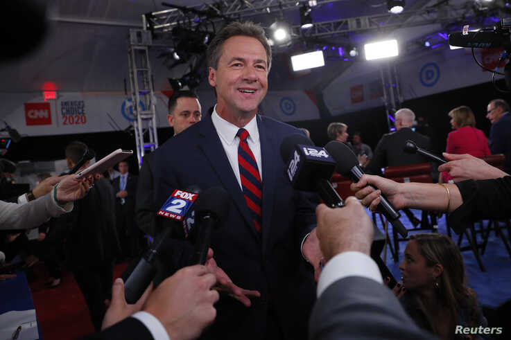 Democratic 2020 U.S. presidential candidate Montana Governor Steve Bullock talks to the media after the first night of the second 2020 Democratic U.S. presidential debate in Detroit, Michigan, July 30, 2019.