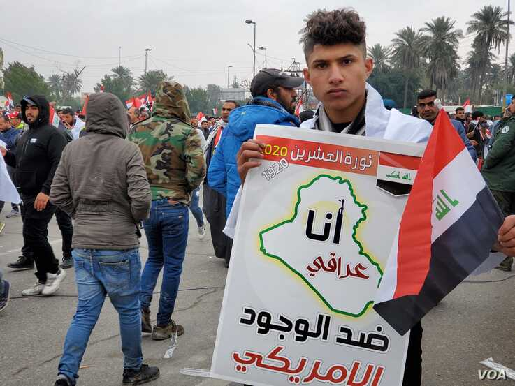 """This protesters sign says """"I am an Iraqi against the presence of America on Jan. 24, 2020 in Baghdad. (H.Murdock/VOA)"""