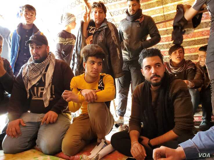 20200125_12841: Young men in Karbala, Iraq say they will stay in their protest camp, despite increasing dangers on Jan. 25, 2020. (H.Murdock/VOA)