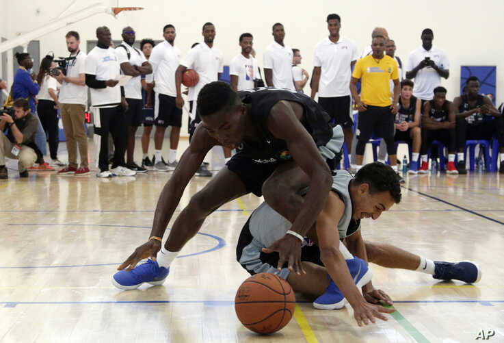 The participants of the Jr. NBA World Championship battle for the ball during the a basketball tournament