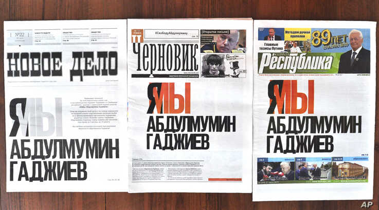 """In this photo, the front pages of Dagestan's three major newspapers use the same headline that reads: """"I'm/we are Abdulmumin…"""