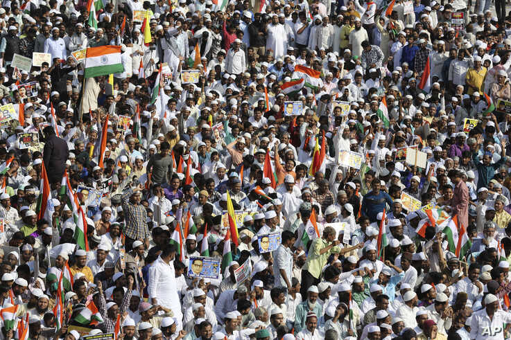 Indians participate in a protest against a new citizenship law that opponents say threatens India's secular identity in…