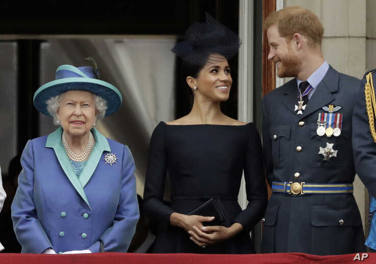 FILE - In this Tuesday, July 10, 2018 file photo Britain's Queen Elizabeth II, and Meghan the Duchess of Sussex and Prince…