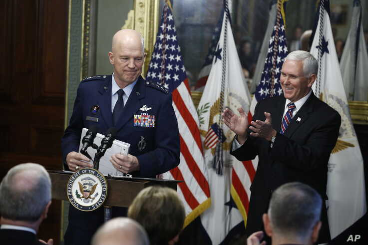 Vice President Mike Pence, right, applauds during swearing in ceremony for Air Force General John Raymond as Chief of Space Operations, in his Ceremonial Office in the White House complex, Jan. 14, 2020 in Washington.