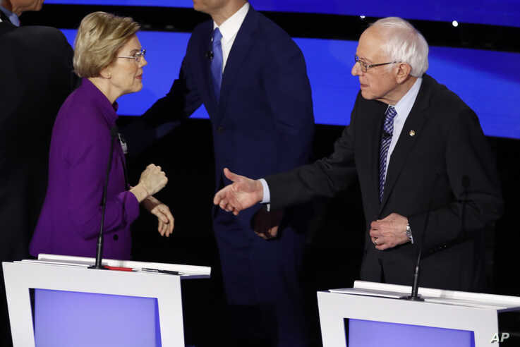 Democratic presidential candidates Sen. Elizabeth Warren and Sen. Bernie Sanders on Jan. 14, 2020, after a Democratic presidential primary debate in Des Moines, Iowa.