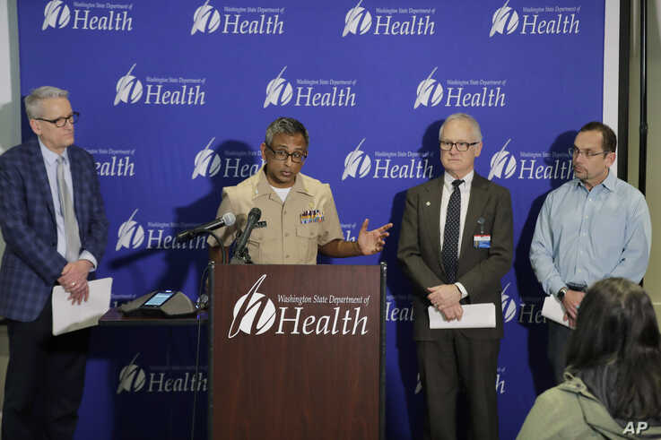 Dr. Satish Pillai, at podium, a medical officer with the U.S. Centers for Disease Control and Prevention, speaks.