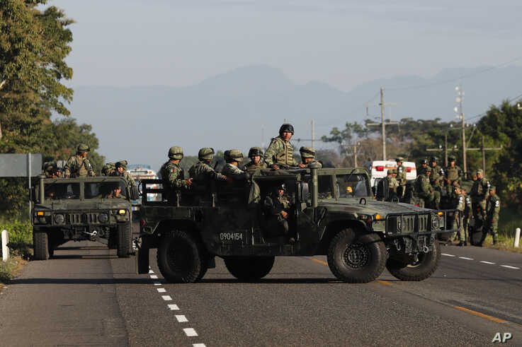 Mexican National Guards block a highway in Ciudad Hidalgo, Mexico after a group of Central American migrants crossed the nearby…