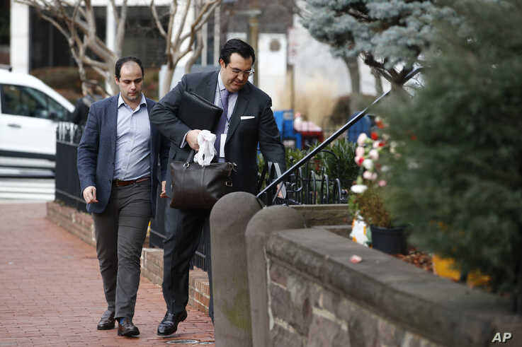 In this Jan. 28, 2020 photo, Jordan Sekulow, right, the executive director of American Center for Law and Justice, opens a gate.