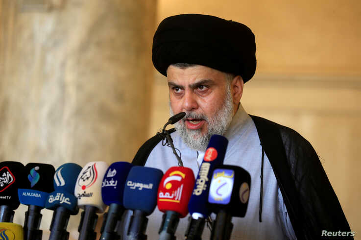 Iraqi Shi'ite cleric Muqtada al-Sadr delivers a sermon to worshippers during Eid al-Fitr prayers marking the end of the fasting…