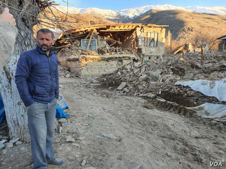 Ramazan Emek surveys the damage in Cevrimtas, near Sivrice, where the quake struck just before 9 p.m. Friday local time.