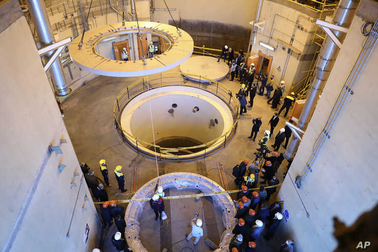 FILE - In this photo released by the Atomic Energy Organization of Iran, technicians work at the Arak heavy water reactor's secondary circuit as officials and media visit the site, near Arak., Dc. 23, 2019.