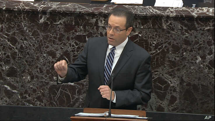 In this image from video, White House deputy counsel Mike Purpura speaks during the impeachment trial of President Donald Trump in the Senate at the Capitol in Washington, Jan. 25, 2020. (U.S. Senate TV/Handout via AP)