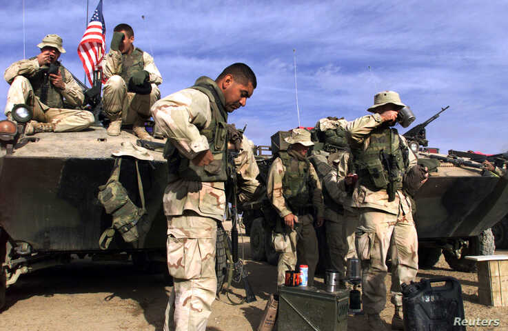 FILE - U.S. Marines are seen at a forward base in southern Afghanistan, Nov. 30, 2001.
