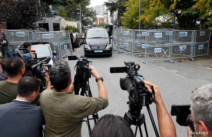 FILE - Journalists are seen during a stake-out in Istanbul, Turkey, Oct. 31, 2018.