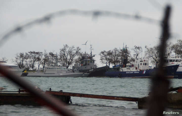 FILE - Three Ukrainian naval ships, seized three days earlier by Russian Federal Security Service (FSB) coast guard vessels, are seen anchored in a port in Kerch, in Russia-annexed Crimea, Nov. 28, 2018.