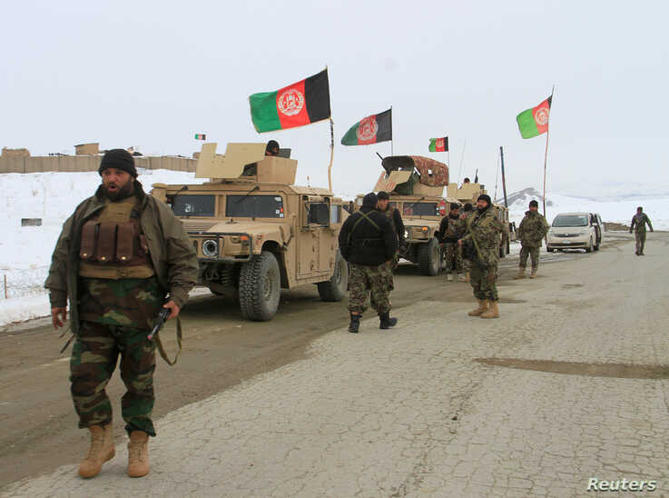 Afghan National Army forces are seen near the site of an airplane crash in Deh Yak district of Ghazni province, Afghanistan, Jan. 27, 2020.
