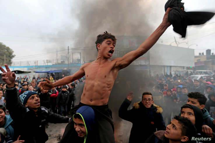 Palestinian students take part in a protest against U.S. President Donald Trump's Middle East peace plan, in the southern Gaza Strip.
