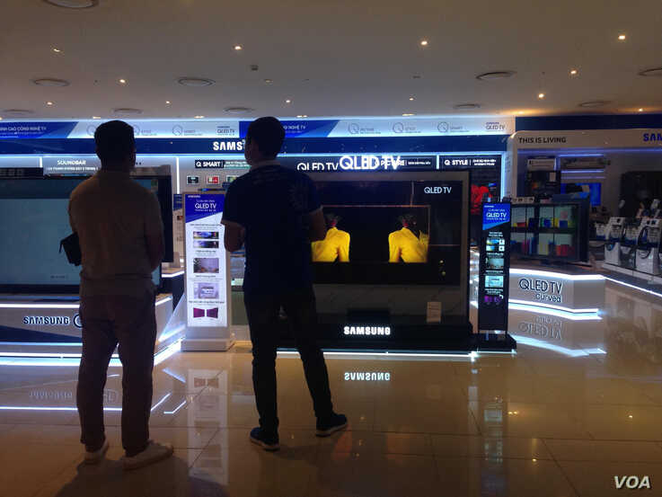 FILE - A shop in Hanoi sells electronics, which are becoming a big export product for Vietnam.