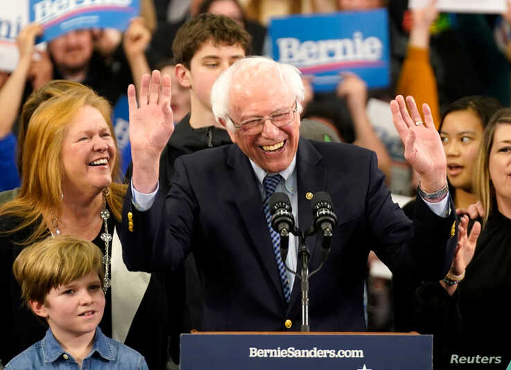 Presidential candidate Senator Bernie Sanders is accompanied by his wife Jane O'Meara Sanders and other relatives as he speaks at his New Hampshire primary night rally in Manchester.
