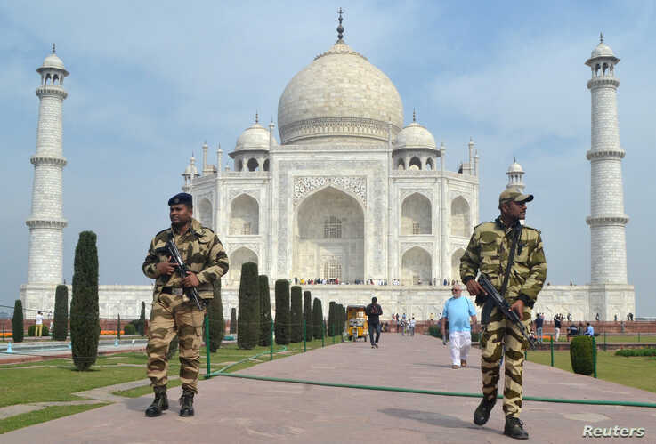 Central Industrial Security Force (CISF) personnel patrol at the historic Taj Mahal premises