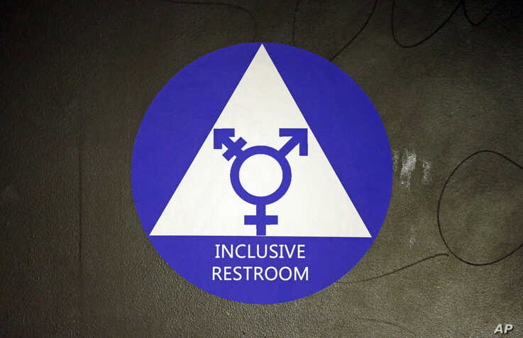FILE - In this May 17, 2016, photo, a sticker designates a gender neutral bathroom at Nathan Hale high school in Seattle.