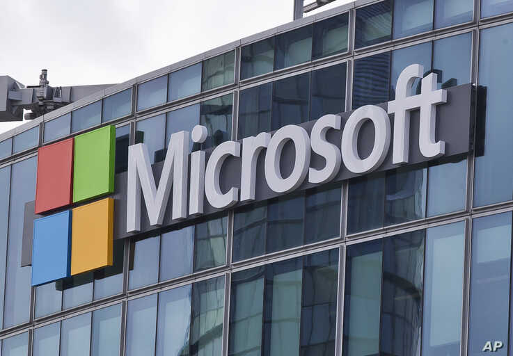 FILE - This April 12, 2016 file photo shows the Microsoft logo in Issy-les-Moulineaux, outside Paris, France. The Pentagon has…