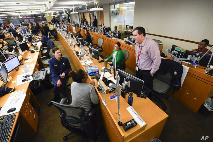 Personnel at the The Centers for Disease Control and Prevention (CDC) work the Emergency Operations Center in response to the 2019 Novel Coronavirus.