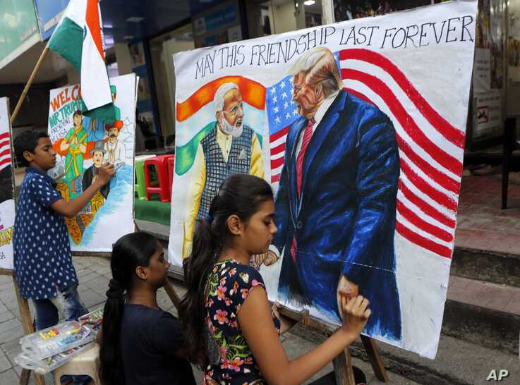Children from an art school make paintings of U.S. President Donald Trump ahead of his India visit, in Mumbai, India