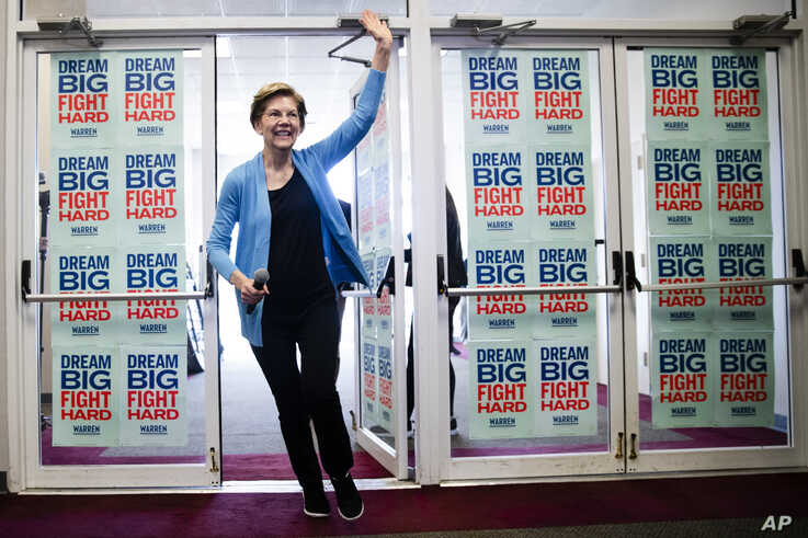 Democratic presidential candidate Sen. Elizabeth Warren, D-Mass., waves to supporters and volunteers, Feb. 29, 2020, in S.C.
