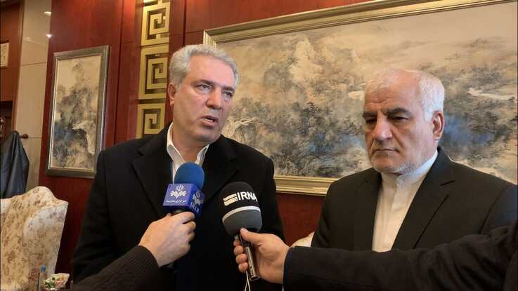 Iranian Tourism Minister Ali Asghar Mounesan (left) speakers to reporters on a visit to Beijing in November 2019, as Iranian Amb