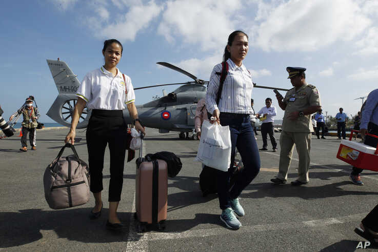 Cambodian medical officers arrive for health checks on passengers and crew of the cruise ship Westerdam in Sihanoukville,…