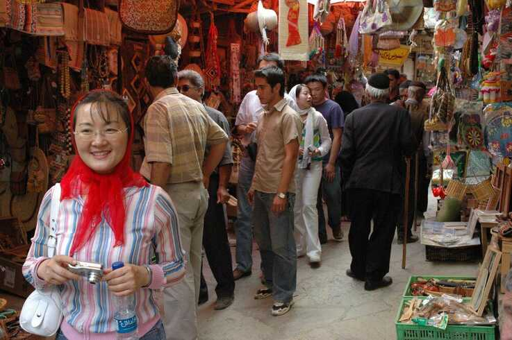 Chinese tourists visit an Iranian bazaar in this undated photo published by the Tehran Times newspaper in November 2019 (Credit:
