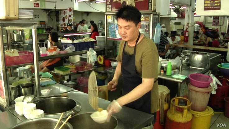 "Alex Lee runs a wonton noodle stall at a popular open air food court in Kuala Lumpur. Lee, a smoker for two-decades, supports enforcement of the smoking ban at all eateries nationwide. ""People should have clean air while they eat,"" he says."