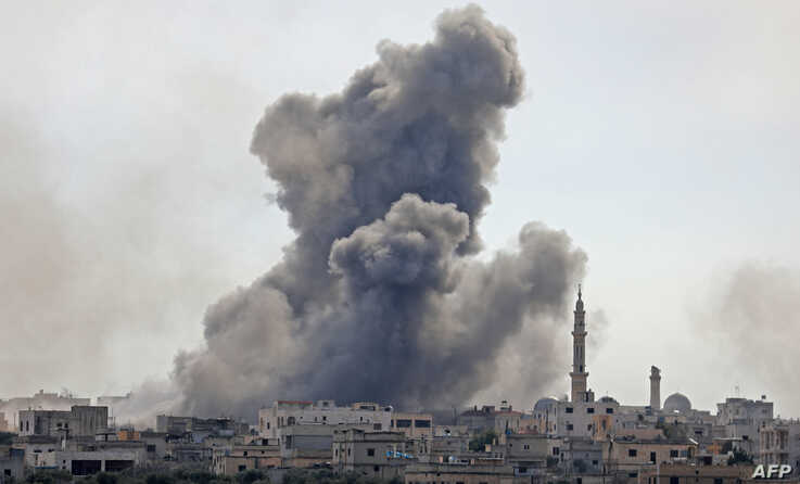 Smoke plumes billow over the Syrian village of al-Nayrab, about 14 kilometers southeast of the city of Idlib, in Syria's northwestern Idlib province, during a bombardment, Feb. 3, 2020.