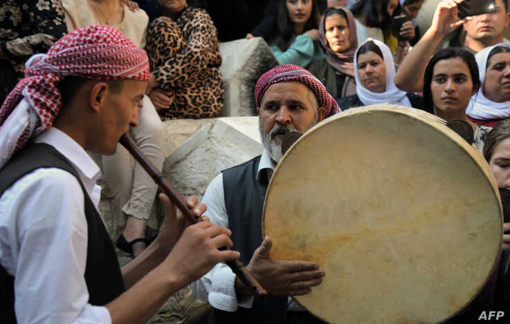 Iraqi Yazidis play traditional music at the Temple of Lalish, in a valley near the Kurdish city of Dohuk, about 430km northwest of the Iraqi capital Baghdad, Oct. 9, 2019.