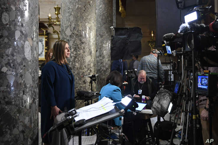 FILE - Democratic Congresswoman Elissa Slotkin speaks during a television interview on Capitol Hill in Washington, Dec. 18, 2019.