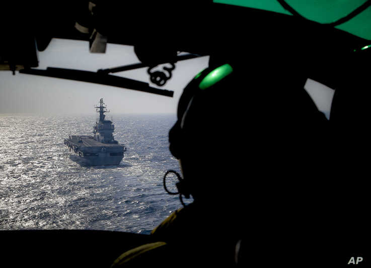 FILE - Italian Navy light aircraft carrier Giuseppe Garibaldi, seen from a helicopter, sails the Mediterranean Sea, off the coast of Sicily, part of the European Union's naval mission Operation Sophia, Nov. 25, 2016.
