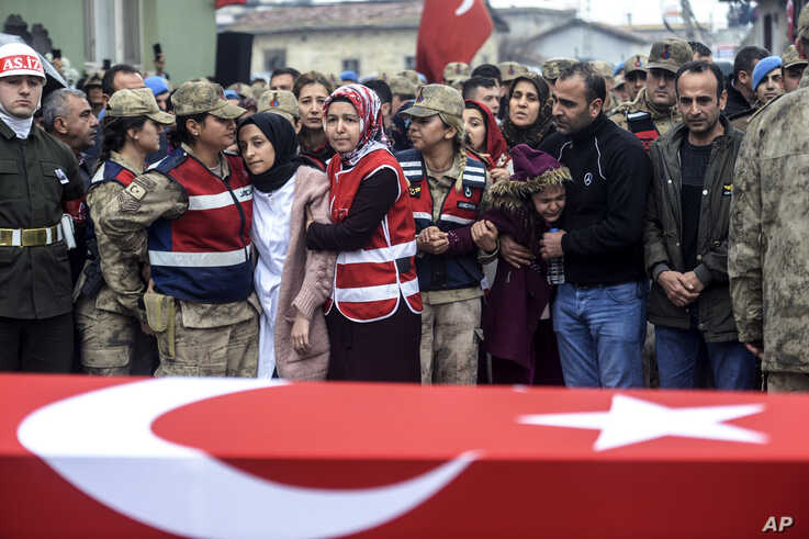 People react by the coffin for Emin Yildirim, one of the 33 Turkish soldiers killed on Thursday in a Syrian army attack in the Idlib region of Syria, at his funeral in Hatay, Turkey, Feb. 29, 2020.